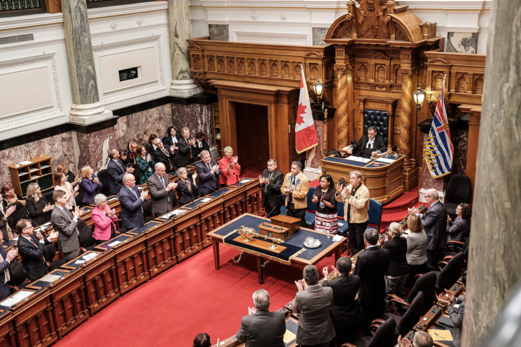 A full BC legislature stands and applauds